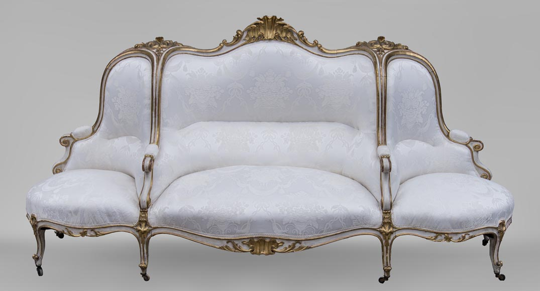 A large Louis XV style bench made out of gilded wood-0