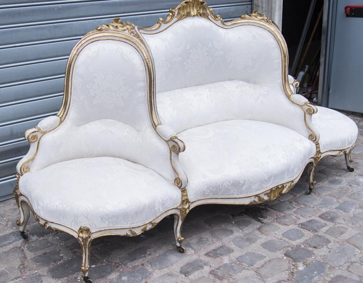 A large Louis XV style bench made out of gilded wood-1