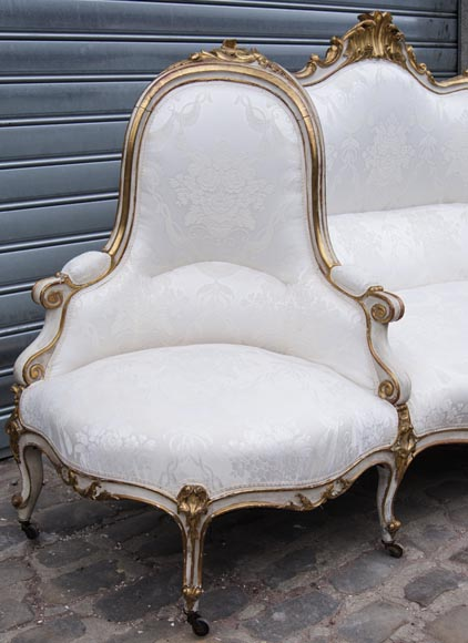 A large Louis XV style bench made out of gilded wood-3