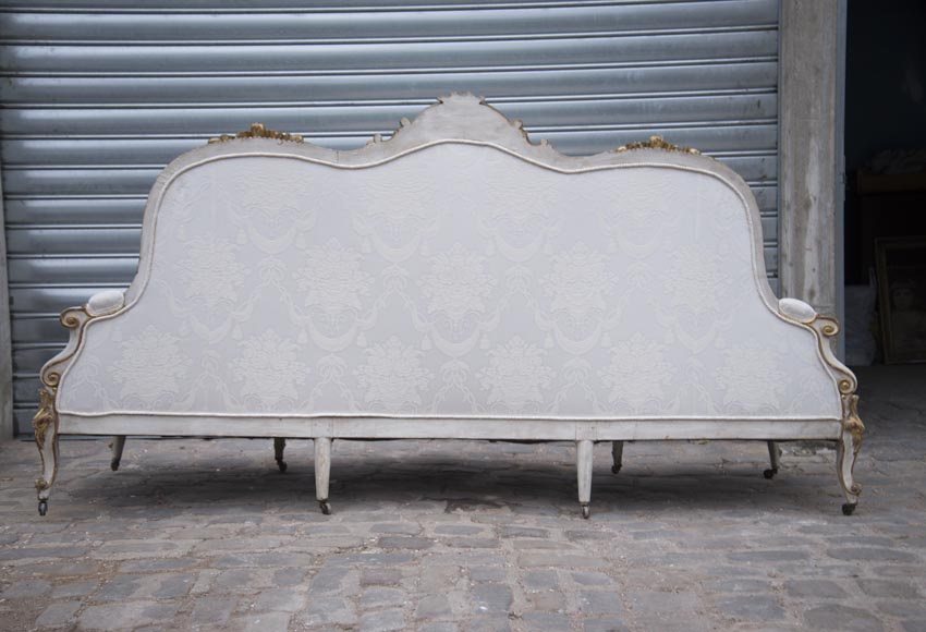 A large Louis XV style bench made out of gilded wood-14