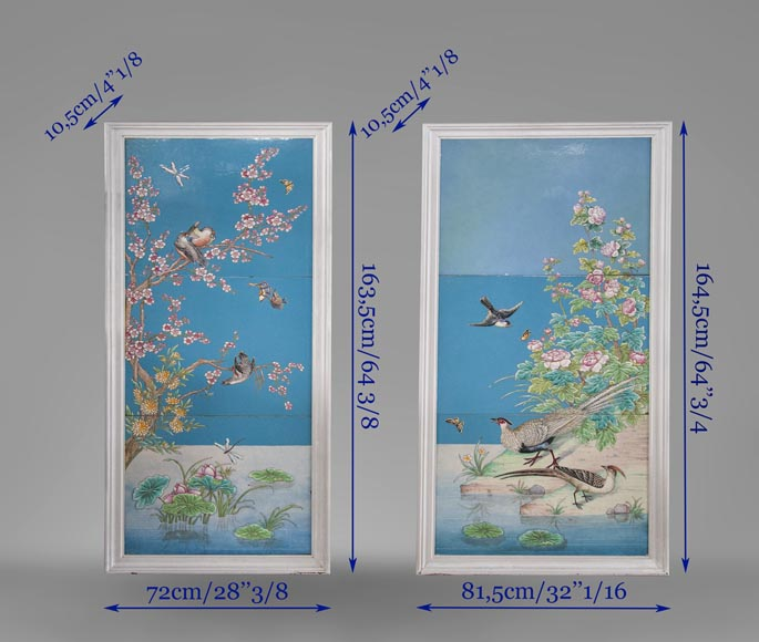 A pair of ceramic panels with birds in a lacustrine scenery signed