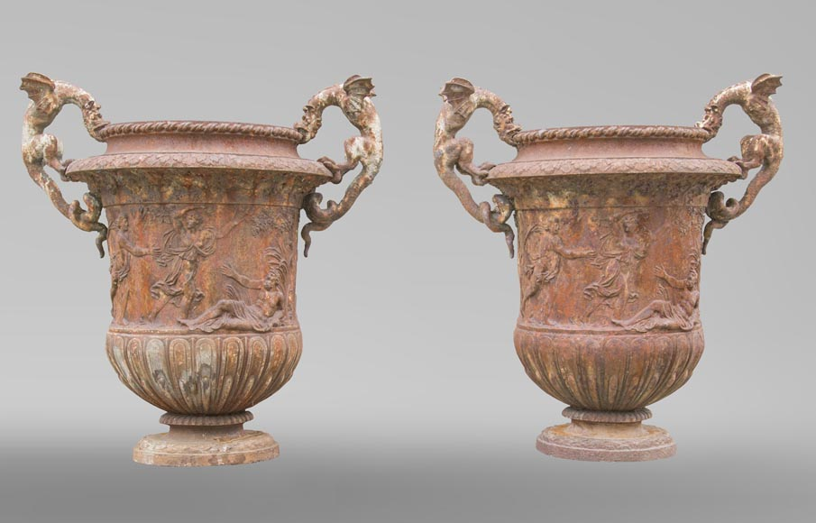 A pair of Renaissance style antique vases made out of cast iron with dragons and a mythological decoration-0