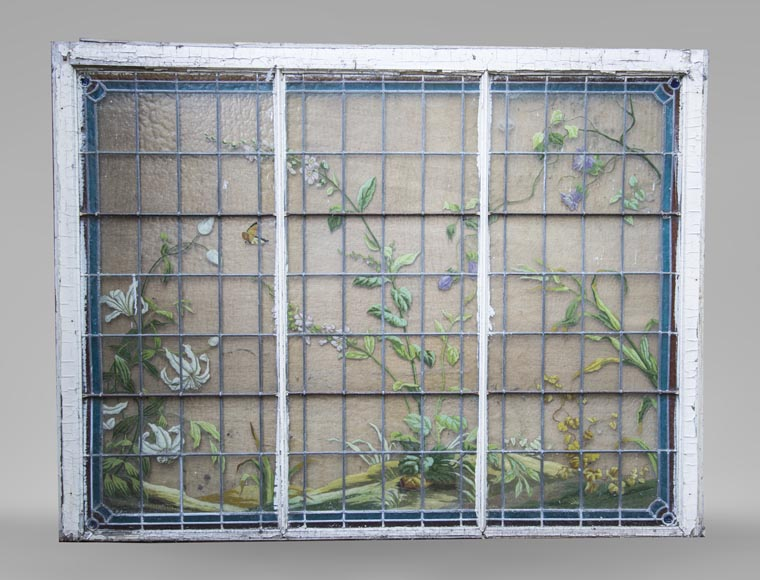 Old stained glass window of a building, decorated with flowers and butterfly-0