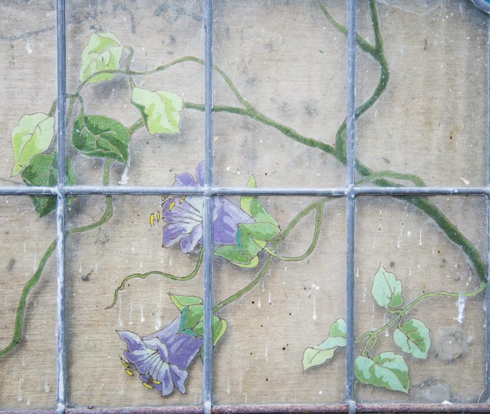 Old stained glass window of a building, decorated with flowers and butterfly-1