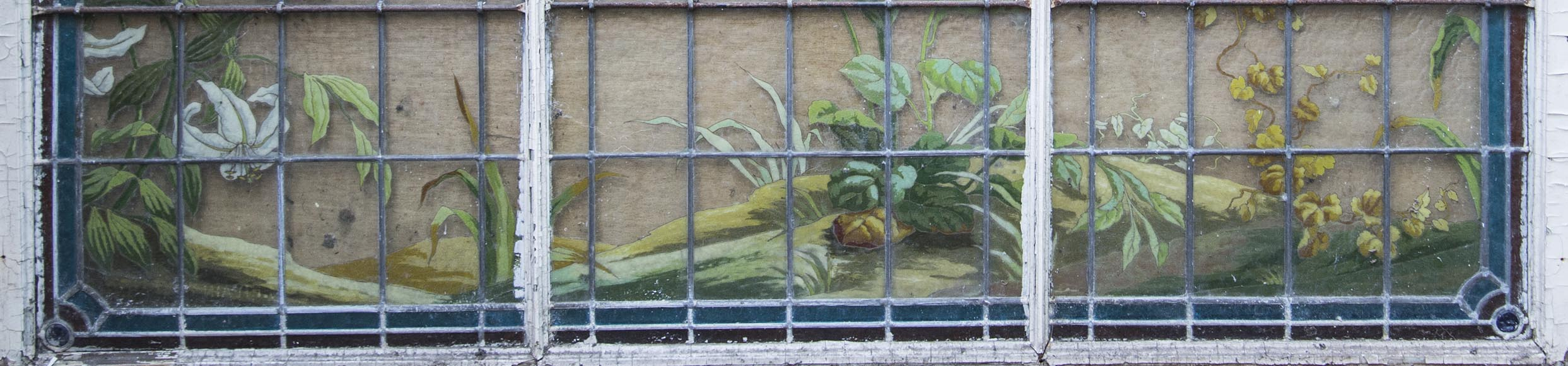 Old stained glass window of a building, decorated with flowers and butterfly-3