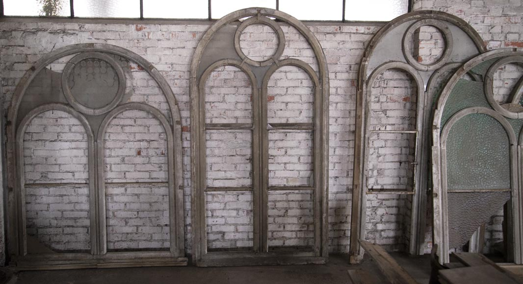 Arched wooden window frames and coloured glass-2