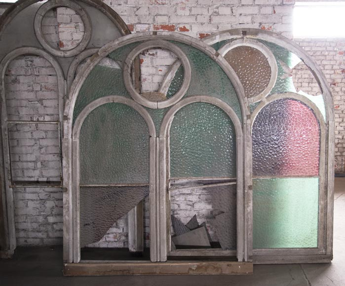 Arched wooden window frames and coloured glass-6