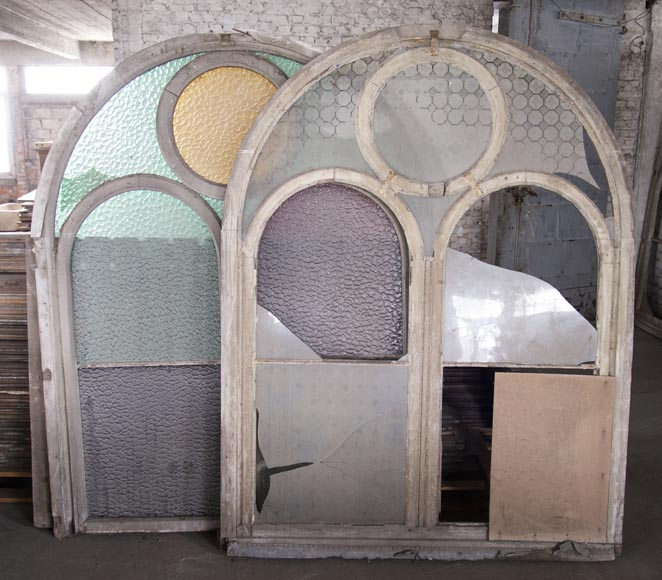 Arched wooden window frames and coloured glass-7