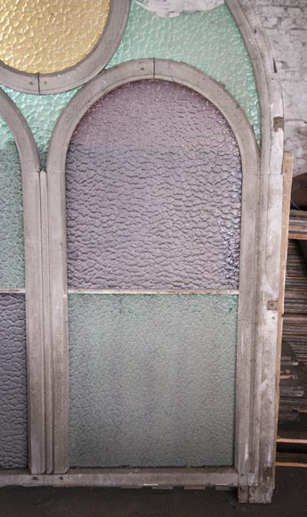 Arched wooden window frames and coloured glass-10