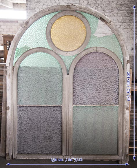 Arched wooden window frames and coloured glass-11