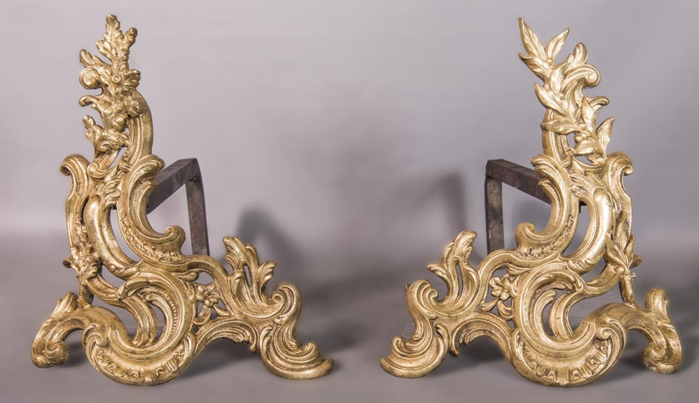 An antique Louis XV style pair of chenets made out of bronze-0