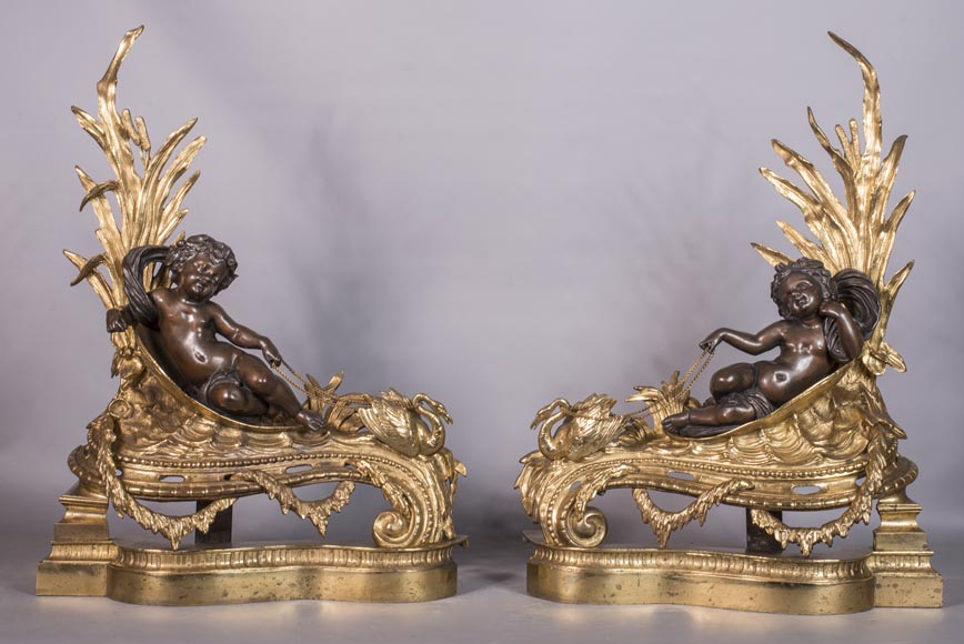 An antique pair of Napoleon III style chenets made out of bronze with two patinas with putti and swans-0