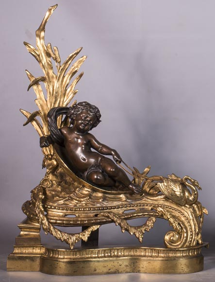 An antique pair of Napoleon III style chenets made out of bronze with two patinas with putti and swans-1