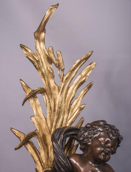An antique pair of Napoleon III style chenets made out of bronze with two patinas with putti and swans-5