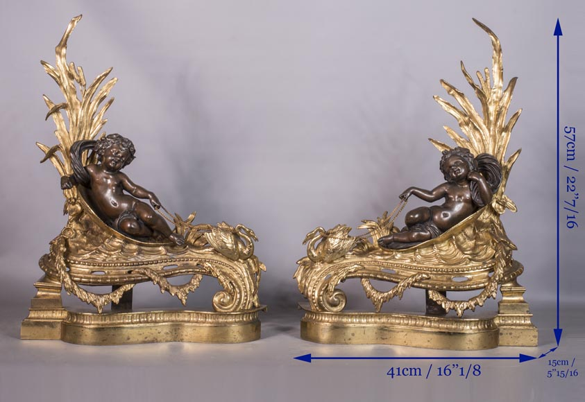 An antique pair of Napoleon III style chenets made out of bronze with two patinas with putti and swans-8