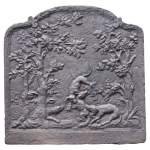 Cast iron fireback with a hutting scene decoration