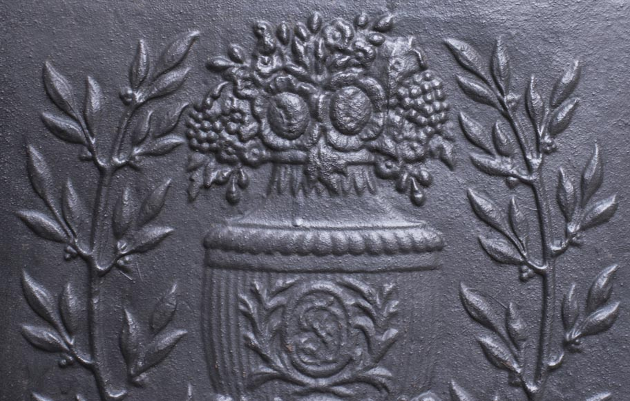 Small Louis XVI style fireback with floral vase decoration-2