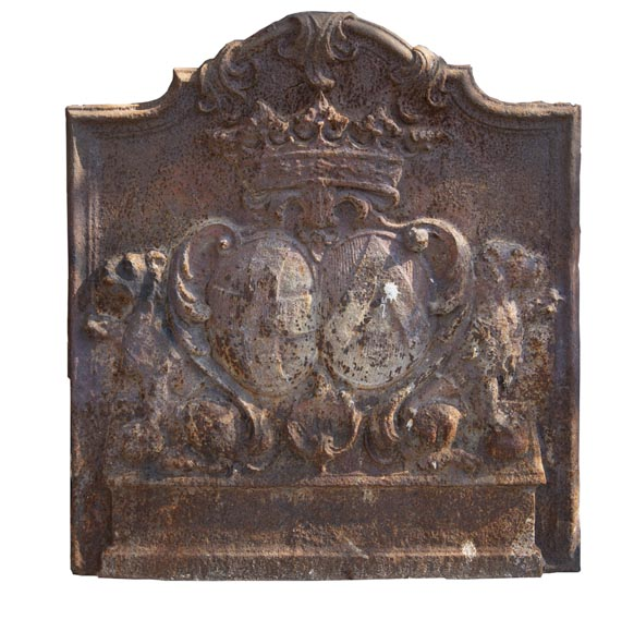 An old 18th century fireback with coat of arms and sitting lions-0