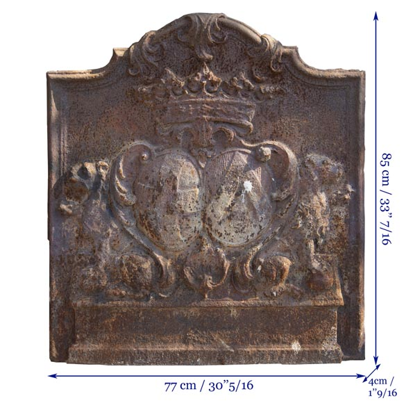 An old 18th century fireback with coat of arms and sitting lions-7
