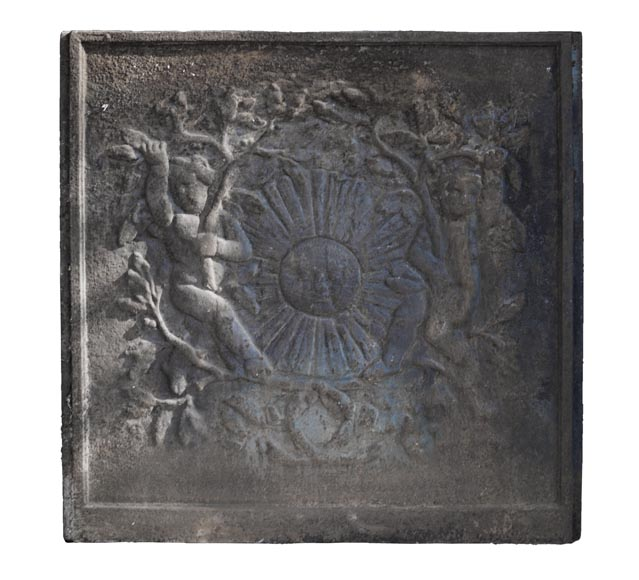 Modern fireback with a Sun King mask framed by two putti-0