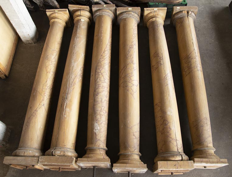 Set of wooden columns painted in imitation marble-0