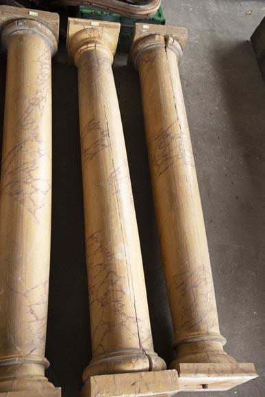 Set of wooden columns painted in imitation marble-1