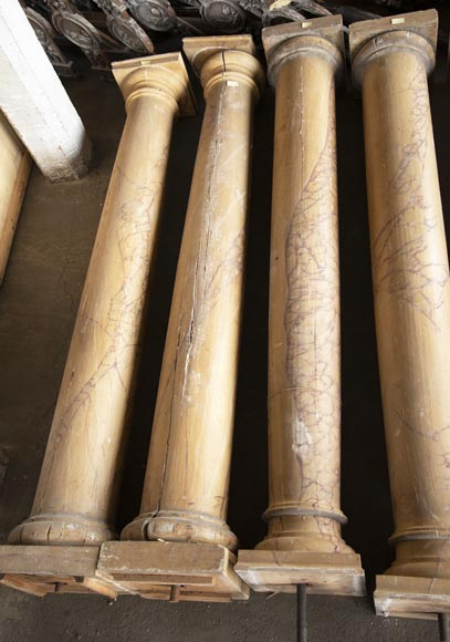 Set of wooden columns painted in imitation marble-2
