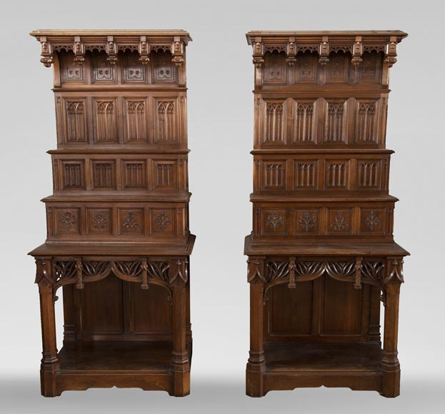 Pair of Neo-Gothic style carved walnut sideboards-0