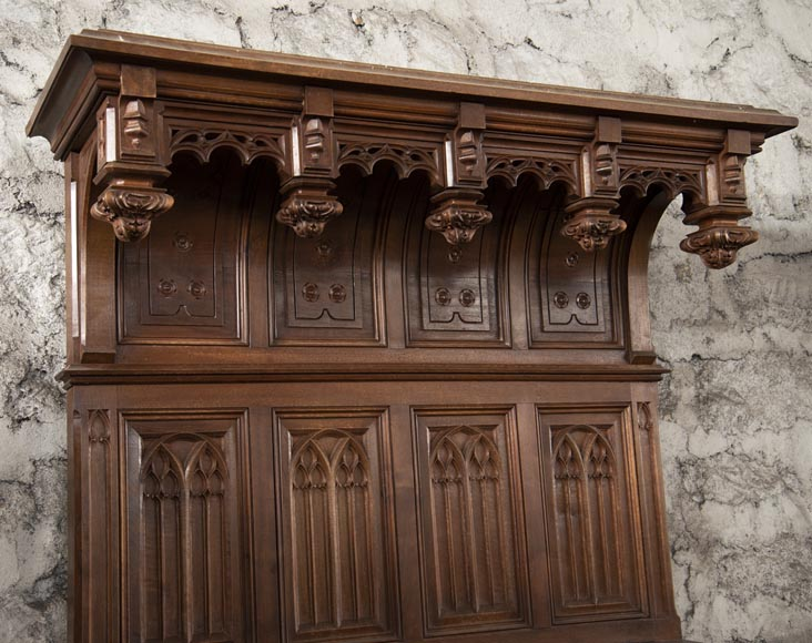 Pair of Neo-Gothic style carved walnut sideboards-2