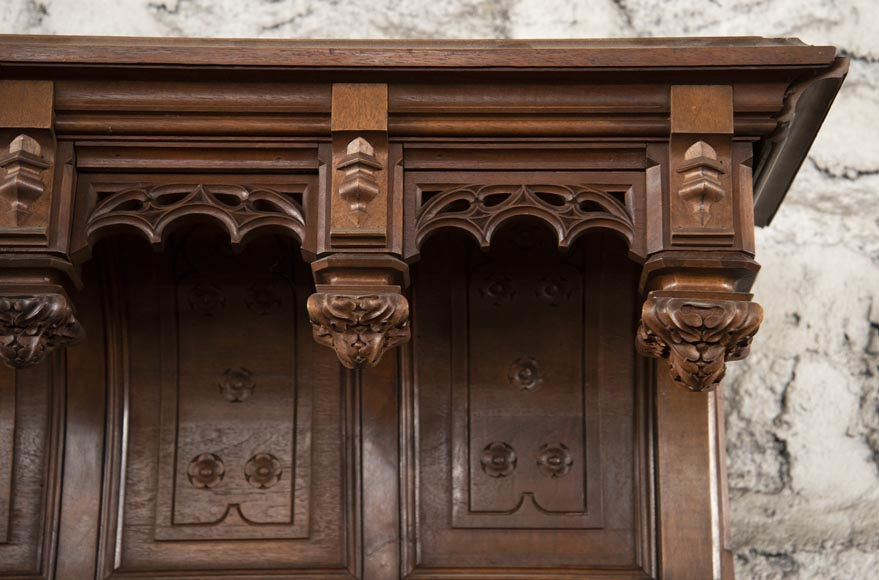 Pair of Neo-Gothic style carved walnut sideboards-3