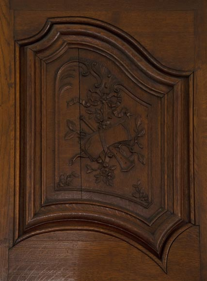 Double door in carved oak decorated with military trophies-2