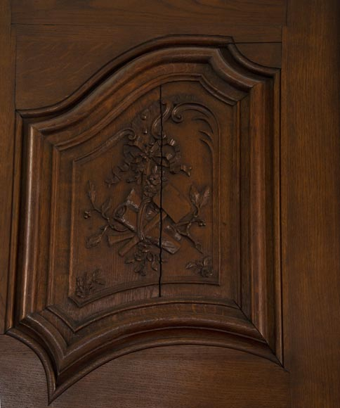 Double door in carved oak decorated with military trophies-3