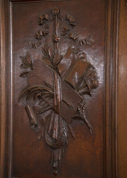 Double door in carved oak decorated with military trophies-6