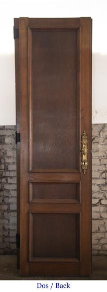 Double door in carved oak decorated with military trophies-8