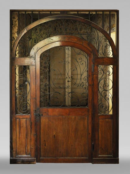 Large mahogany door and wrought iron arabesques-0
