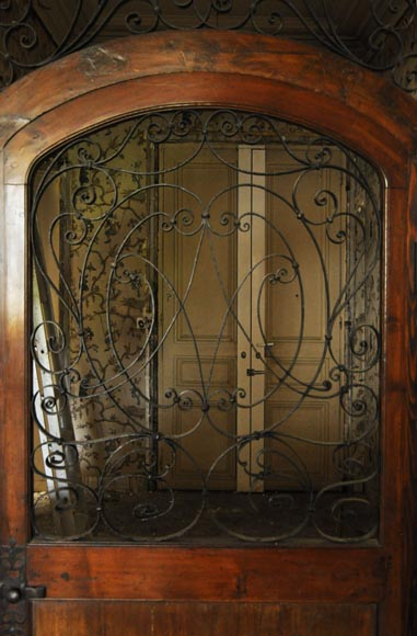 Large mahogany door and wrought iron arabesques-1
