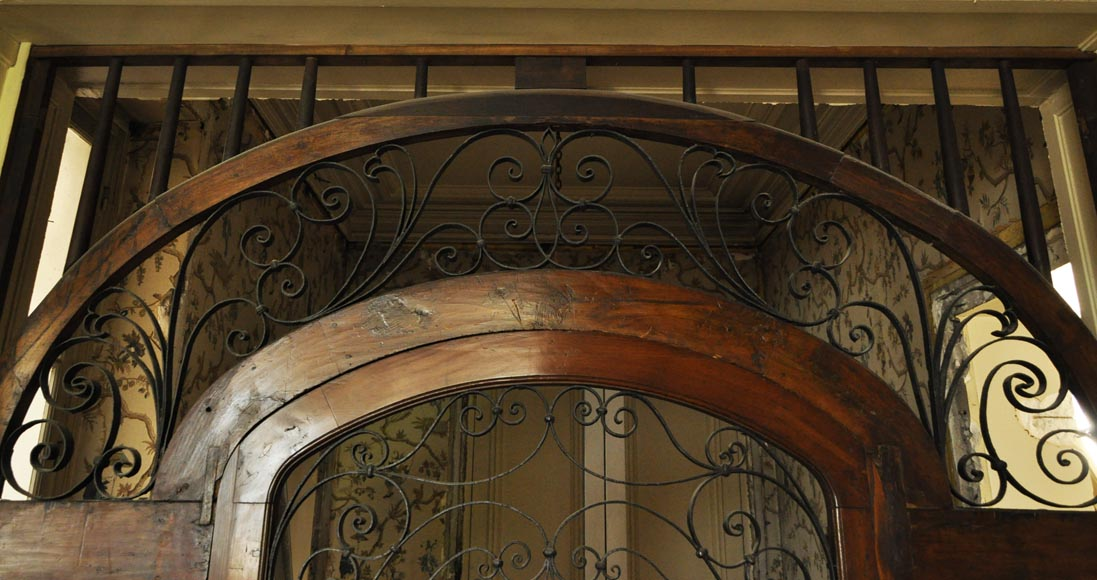 Large mahogany door and wrought iron arabesques-2