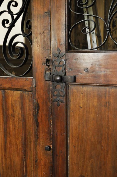 Large mahogany door and wrought iron arabesques-5