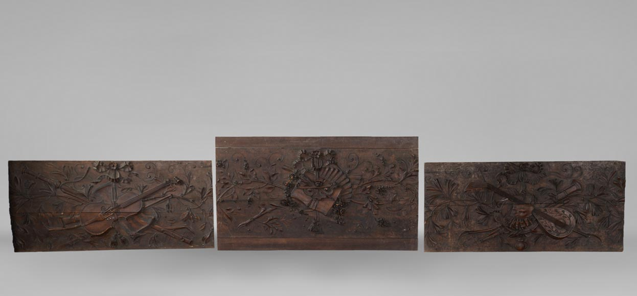 Set of three antiques carved walnut decorative panels with attributes of the Arts-0