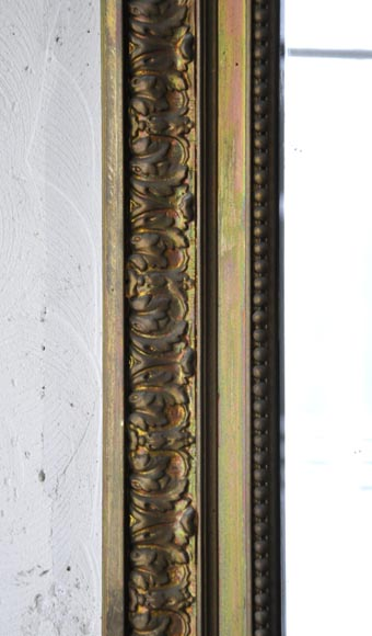 Antique Regence style overmantel pierglass with quiver and torch decor in