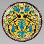 Théodore DECK (1823-1891) - Round ceramic dish with oriental decoration of a vase of flowers and foliage on yellow background