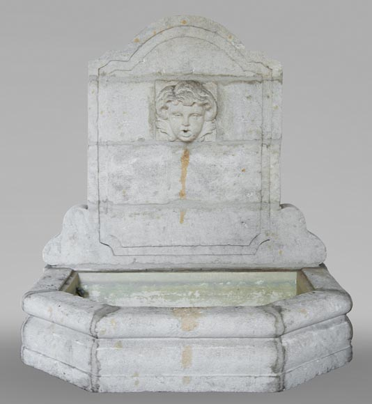 Stone fountain with a child's mask-0