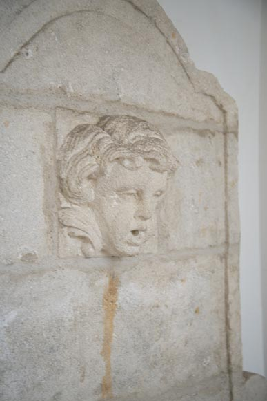 Stone fountain with a child's mask-4