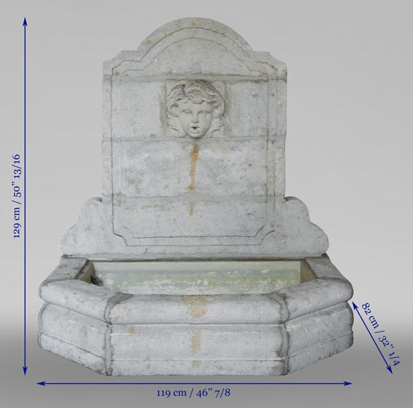 Stone fountain with a child's mask-7