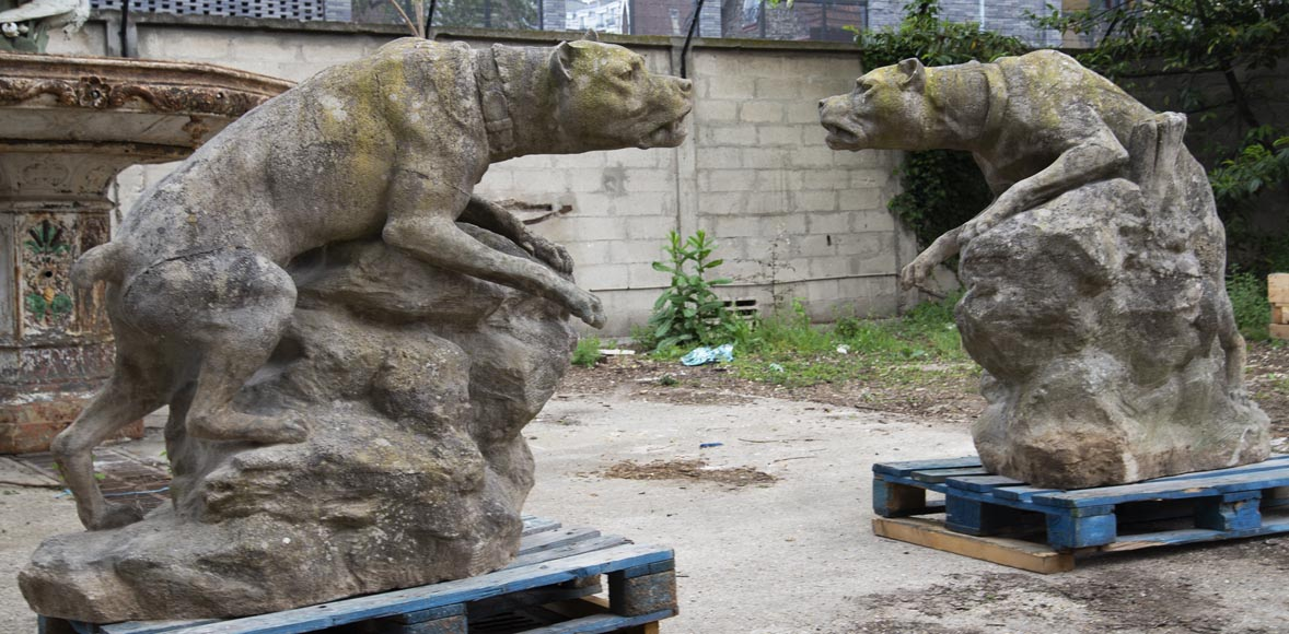 Pair of composite stone fighting dog statues-0