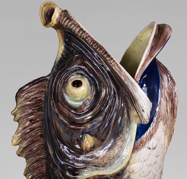 Earthenware umbrella holder representing a fish coming out of a wave-2