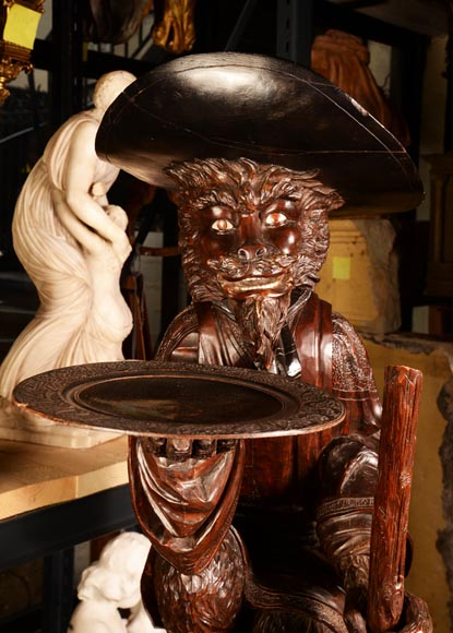 Large monkey dressed and capped in carved wood, forming a display-1