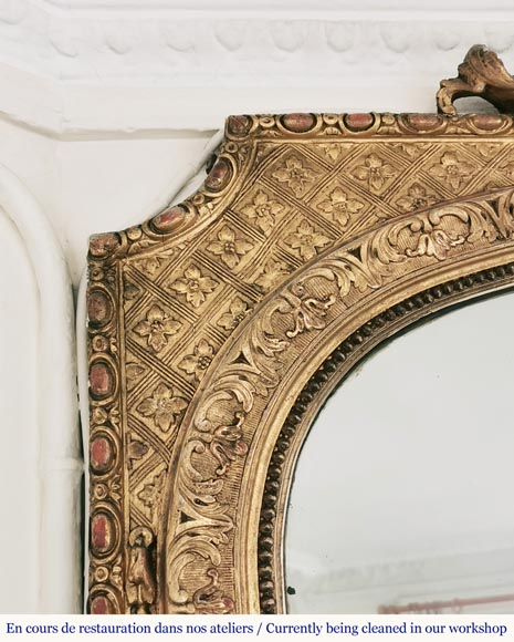 Regence style gold wood and stucco overmantel with a rich decor-4