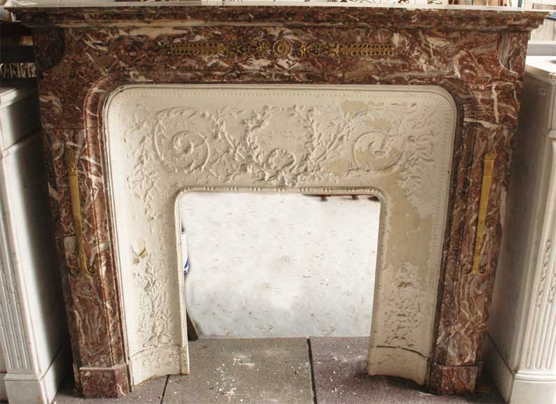 Transition style fireplace with bronze ornaments-0