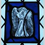 Four stained glasses with greyness angels